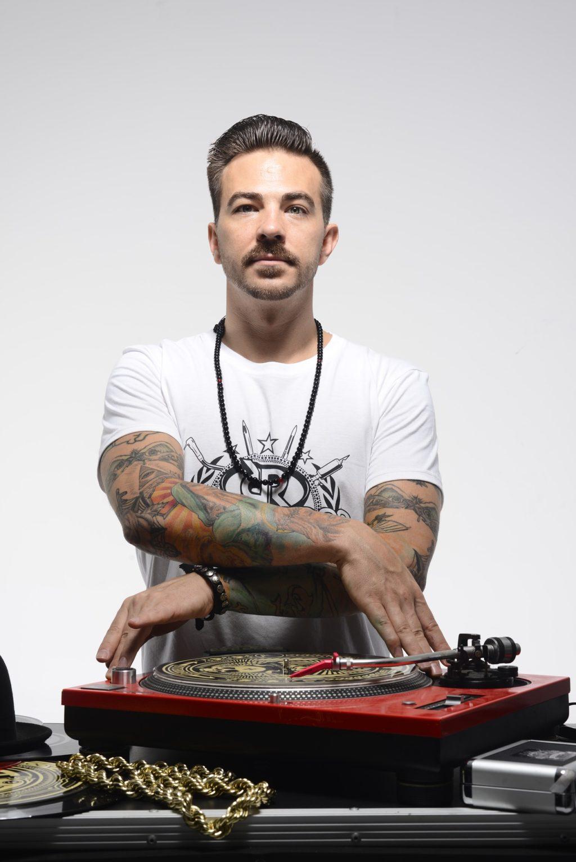 Arturo Alvarez Demalde shows off his DJ skills on the turntable